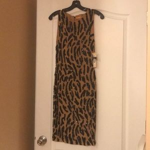 Alice + Olivia nude and black dress never worn